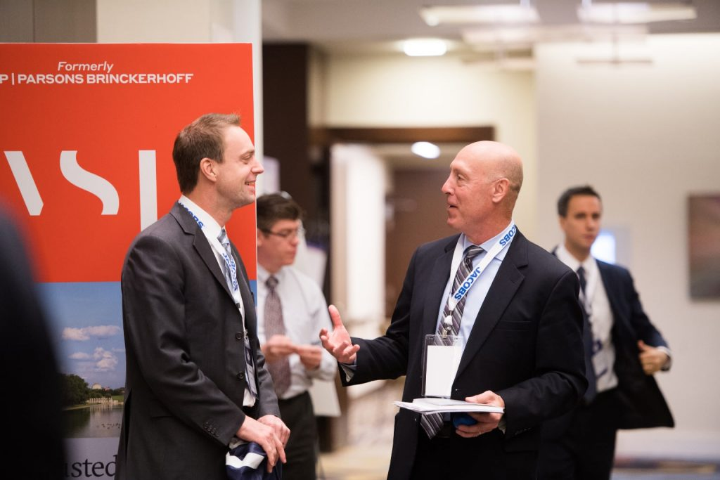 colleagues networking at a booth