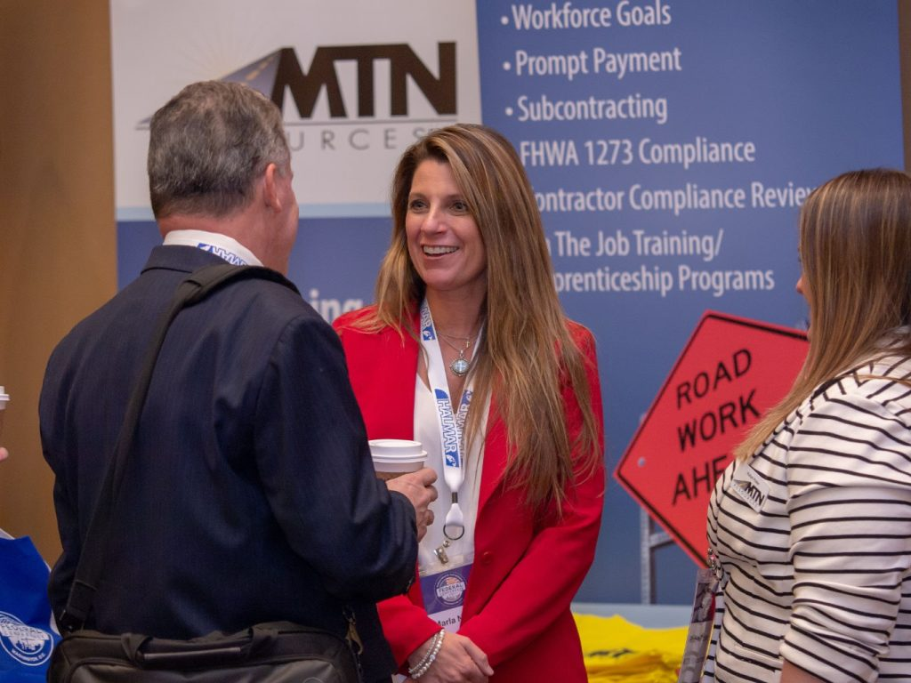 networking at an exhibit booth